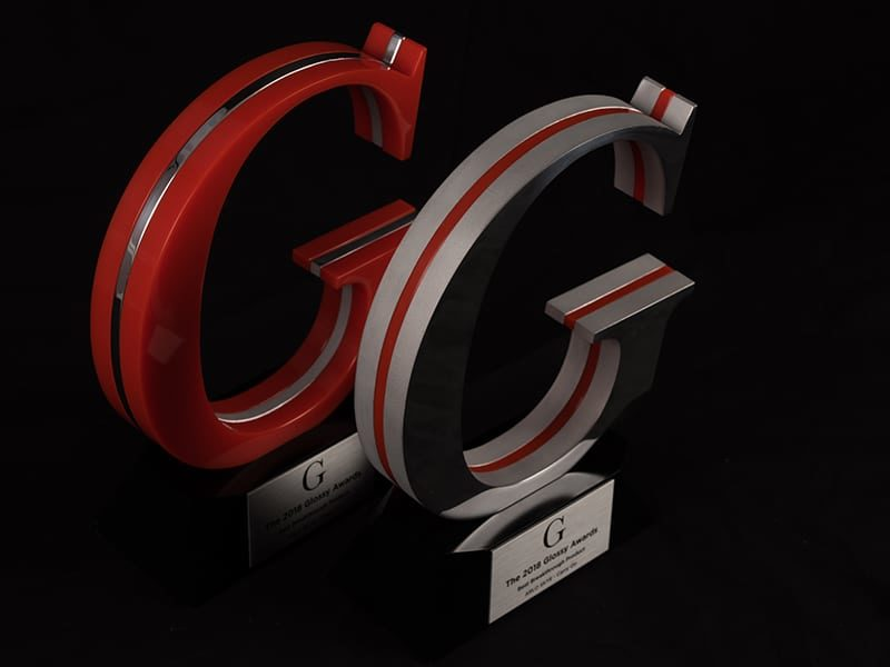 Red And Gray Acrylic And Metal Awards Of Company Logo