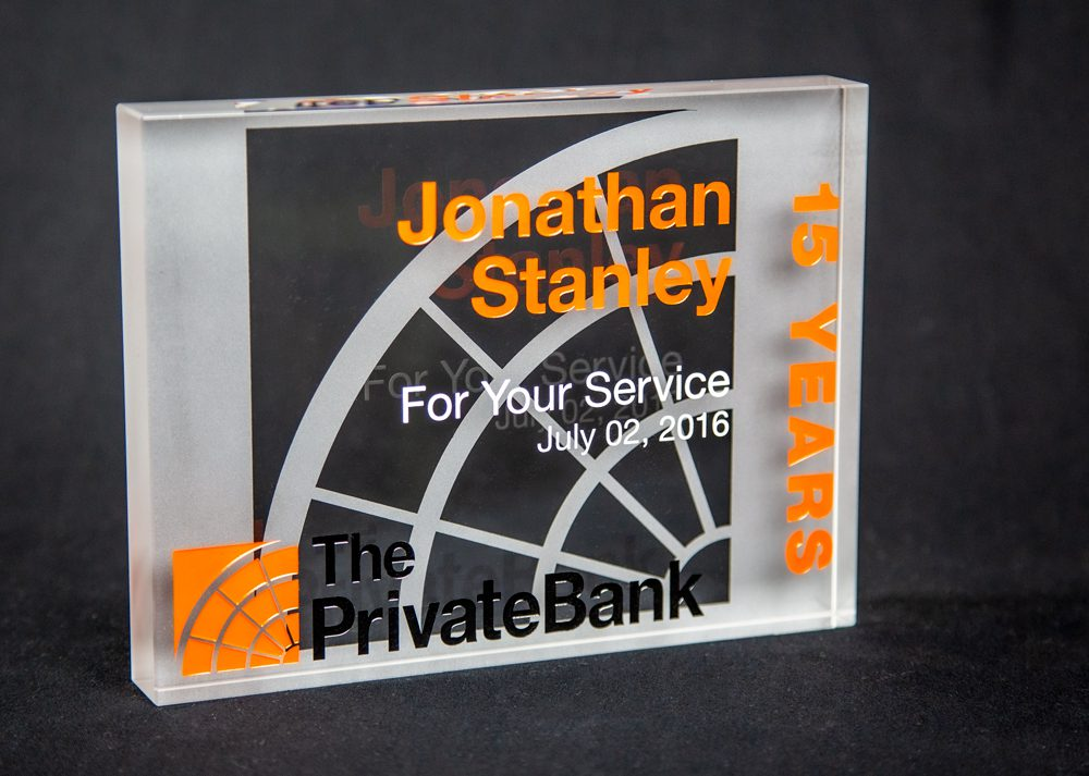 Crystal service award reverse sand etch on backside. Sand etch and color fill on frontside