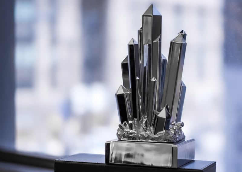 Metal crystals coming out of ground custom smithsonian award